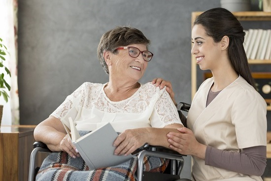 Woman in wheelchair with nurse